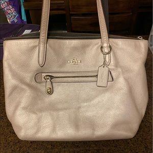 Rose gold Coach handbag